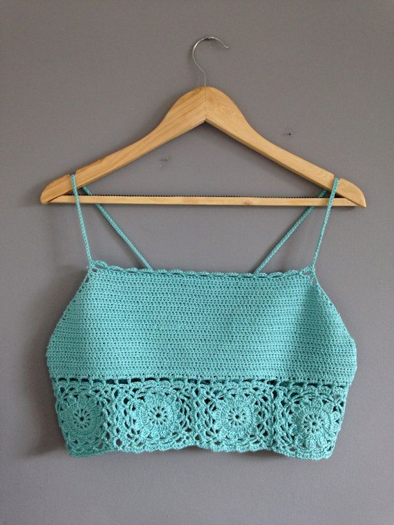 This lovely soft, baby blue crop top is perfect for any summers day! It has beautiful detailing around the bottom of the top and is finished with two delicate straps :) Size- M. (Approx 10-12)  Made with 100% macerated cotton. – Aynur Tercioğlu