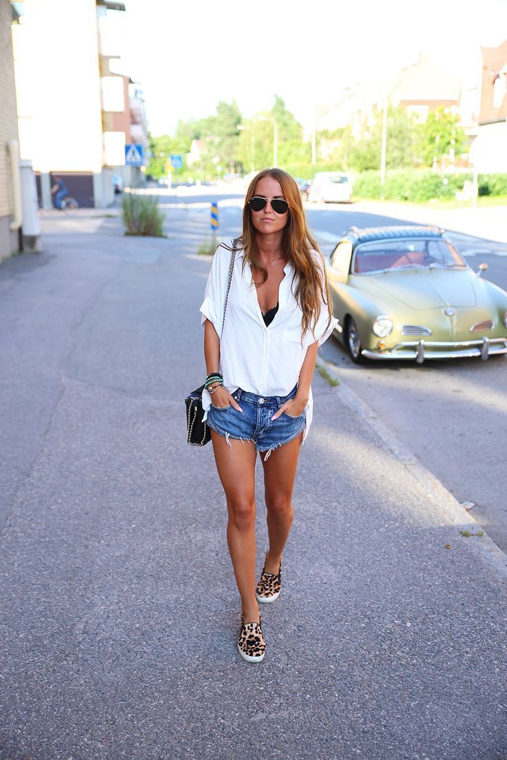 Shop this look on Lookastic:  https://lookastic.com/women/looks/button-down-blouse-shorts-slip-on-sneakers-crossbody-bag-sunglasses/12299  — Black Sunglasses  — White Button Down Blouse  — Black Leather Crossbody Bag  — Blue Denim Shorts  — Tan Leopard Slip-on Sneakers