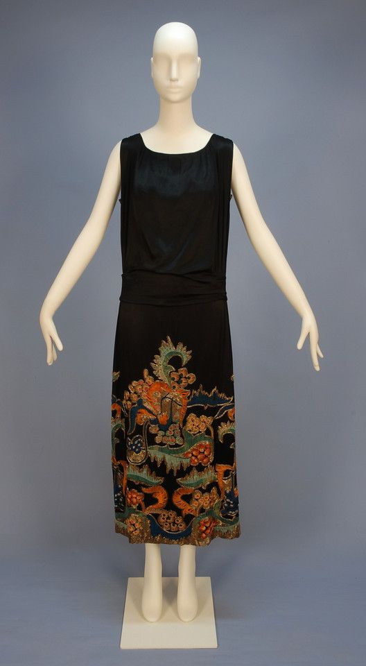 DOEUILLET EMBROIDERED and BEADED EVENING DRESS, 1920's. Sleeveless black silk charmeuse heavily embroidered in vibrant shades of orange, aqua, blue, pink and yellow with gold bugle beads in an abstract floral on the upper back and over-skirt front and sides, self sash having back loop and drape, cream silk under dress having applied lace to the sides.  whitakerauction.com: Aqua Blue, 1920S Style, 1920S Fashion, 1920 S Fashion, 1920S Clothing, Black Silk, Bugle Beads, 1920S Dresses, Dresses 1920S