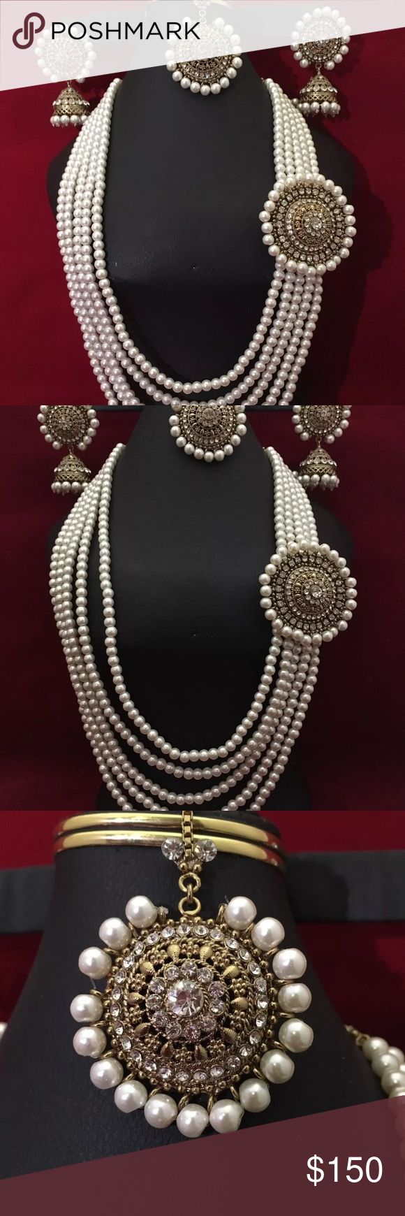 Nwot Mughal Indian jewelry set New Mughal style pearl beads attached with rhinestones pendent . Set include earrings , matha Tikka and long necklace Earrings are jhumki style Picture took in different lights to show you the exact colors . Very beautiful in front .  Please ask any question before bidding all sales are final no return accepted.  Thank you Jewelry Necklaces