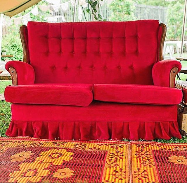 Our Audrey sofa and huge retro rug doing their pretty thing. All included in our unlimited hire range.  #vintage #sofa #lounge #hire #props #prophire #bride #groom #innerwest #sydney #drummoyne #retro #red #wedding #picnic