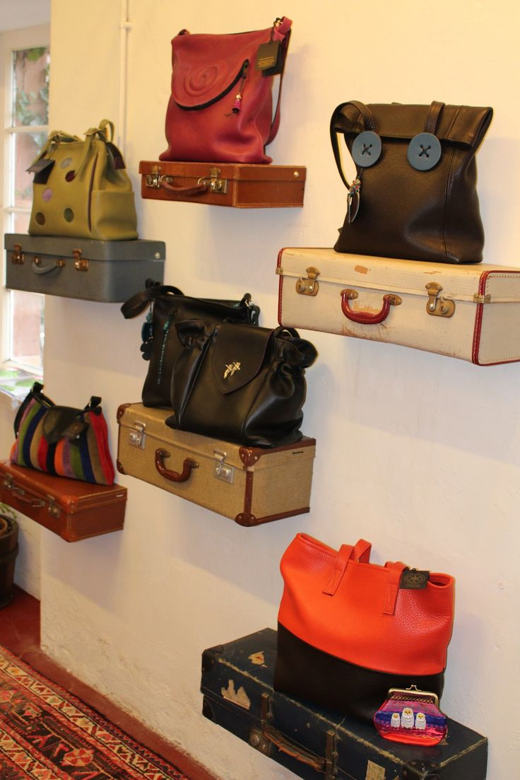 Handbag display, new life for vintage suitcases. Visual merchandising. Retail store display. Women's accessories. Purses.