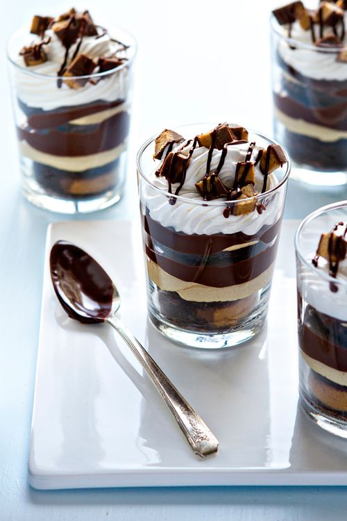 Peanut butter brownie parfaits have layers of brownies with peanut butter cups, peanut butter mousse, and lots of chocolate ganache. Valentine's Day perfection!