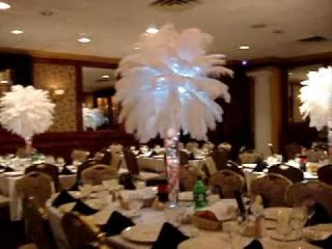 rent coral orchids with white ostrich feather centerpieces. Black Bedroom Furniture Sets. Home Design Ideas
