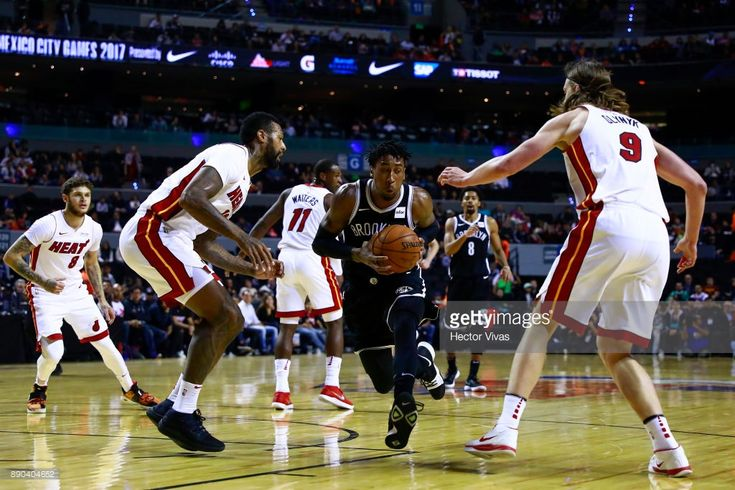 Rondae Hollis Jefferson of Brooklyn Nets handles the ball against James Johnson and Kelly Olynyk of Miami Heat during the NBA game between the Brooklyn Nets and Miami Heat at Arena Ciudad de MÈxico on December 9, 2017 in Mexico City, Mexico.