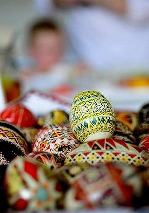 **Ukrainian Eggs** Along with cracking eggs, it is a Ukrainian Easter tradition to paint eggs. First you drain the eggs by poking a very tiny hole in it with a sharp pin at the top and wait for it to drain, which can sometimes take all night. Once they are drained and dried, you paint a traditional pattern or style on it.