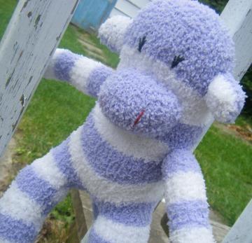 Purple and white fuzzy sock monkey on #Zibbet