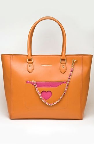 Love Moschino bag Large orange bag, with small detachable pink wallet/clutch, with chain. Heart-shaped opening. 35 cm width at bottom. 100%POLYURETHANE Code: JC4315PP0ZKM1