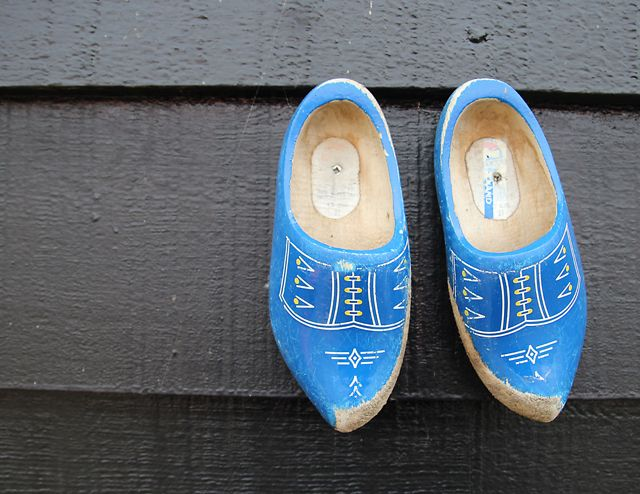 A traditional design painted on bright blue wooden shoes - Dutch cuteness!