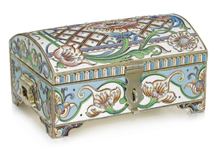 A silver-gilt and cloisonné enamel casket, Moscow, 1899-1908 with shaded enamel flowers and leaves on cream and turquoise-coloured grounds, the arched lid with beeded trellis pattern