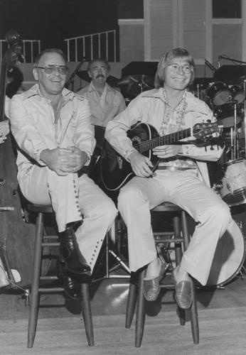 John Denver and Frank Sinatra in 1975.  The two were in a back-to-back booking at Harrah's Tahoe in 1975.  Denver played the supper shows; Sinatra did the midnight shows.  JD also sang a duet with Sinatra on the Sinatra and Friends TV special.  SGS