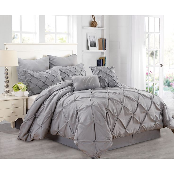 the free flowing pintuck pattern of this stunning comforter set covers the whole comforter