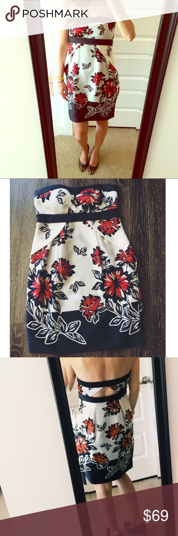 PRICE CUT Size 2 BCBG flower dress with cutout Size 2 BCBG red, black and white silky cocktail dress! Sexy triangle back cut out - perfect for summer weddingshits above the knee. Has been worn twice. Has built in cups. BCBG Dresses Mini