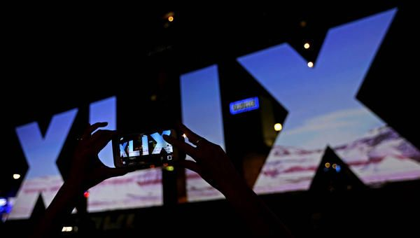 A woman takes a photo of Roman numerals for Super Bowl XLIX Wednesday, Jan. 28, 2015, in downtown Phoenix. The New England Patriots face the Seattle Seahawks in Super Bowl XLIX on Sunday in Glendale, Ariz. (Charlie Riedel, AP)