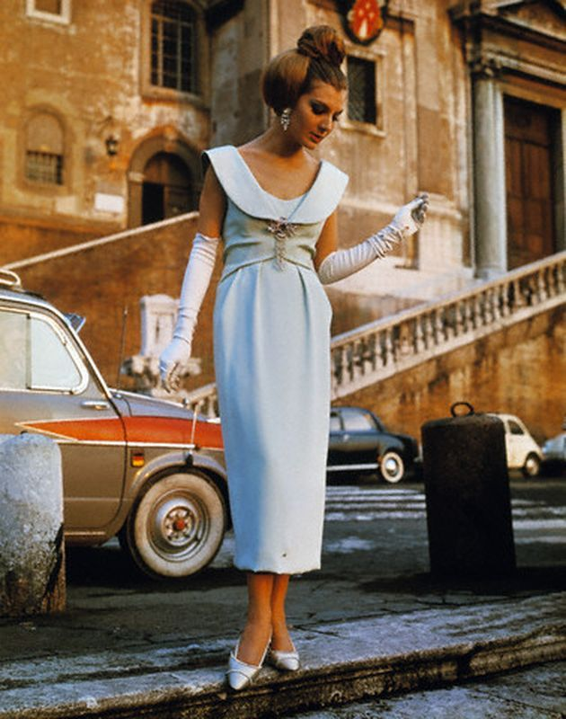 """Roma, Jan 1964. Sorelle Fontana dress © Corbis. """"The Fontana Sisters of Rome create a new look for Spring evenings in 1964: This fashion headliner, reminiscent of the post war 'new look' introduced by Christian Dior, has created a stir in the Italian capital....Done in pale, pale green silk, the evening dress is styled with a slightly raised waistline, a fitted bodice with a deflated-life-belt collar and a softly tucked skirt which ends just above the ankles."""""""