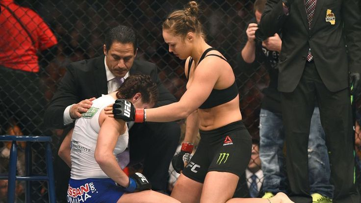 LOS ANGELES, CA - FEBRUARY 28: (R) Ronda Rousey consoles Cat Zingano after their UFC women's bantamw... - Zuffa LLC via Getty Images