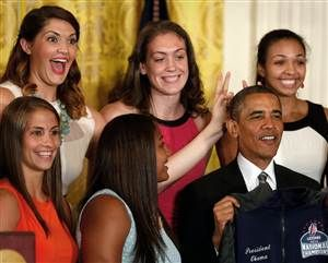 Surprise! UConn basketball players give President Obama 'bunny ears'  (Photo: Larry Downing / Reuters)