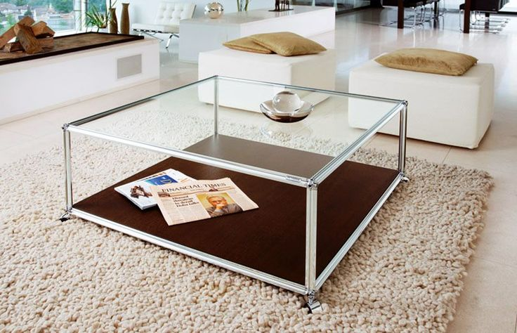 cool square glass coffee table with wood platform at the bottom | credit