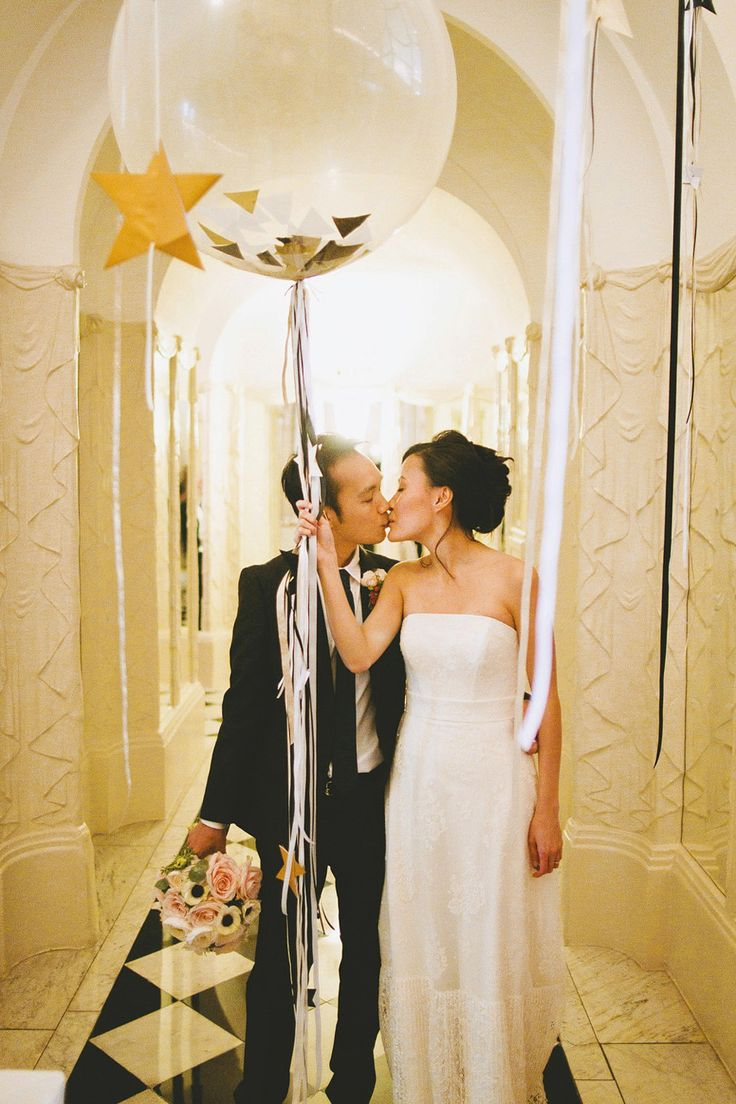 Large white balloon with gold glitter | Photography by http://davidjenkinsphotography.com/