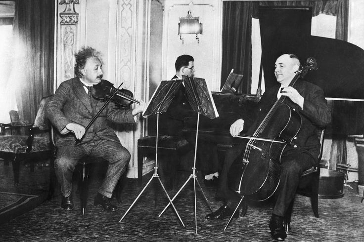 Picture of Albert Einstein playing with an ensemble