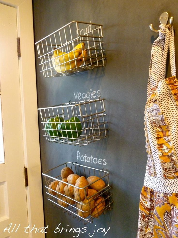 Baskets from Crate & Barrel, hang with hooks so they can be removed when being used.