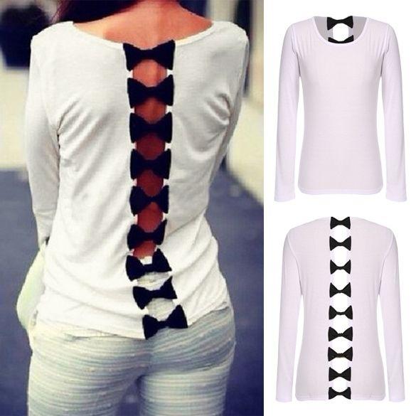 17.00€ avant réduction de 35>%. Top fashion blanc ajouré & noeud noir dans le dos - bestyle29.com