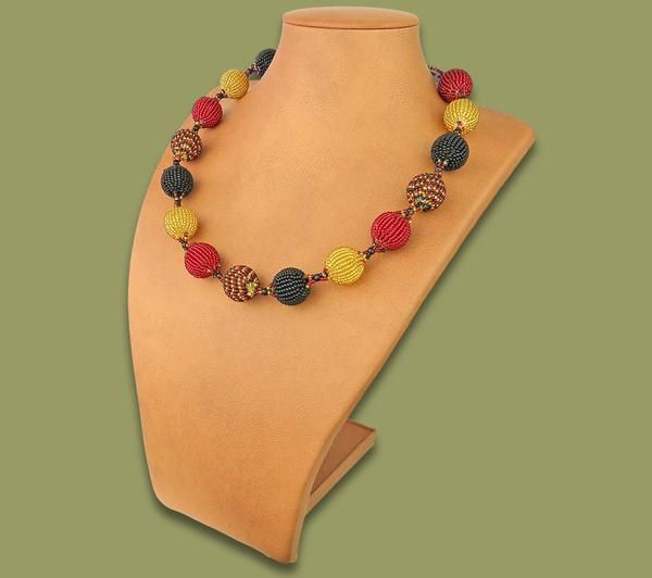 An African souvenir online shop offers African #BeadedBobbleNecklace. These unique Beaded Bobble Necklaces are made by talented African rural men and women.