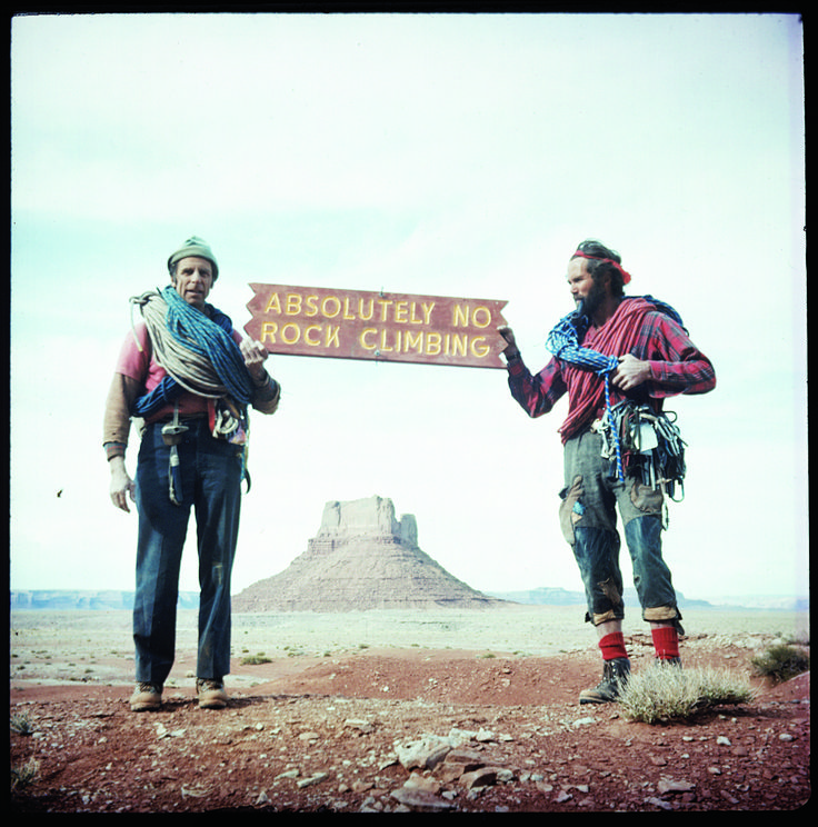 """""""Fred Beckey (left) and Eric Bjørnstad holding a sign found in Canyonlands, Utah."""" Photo by Fred Beckey"""