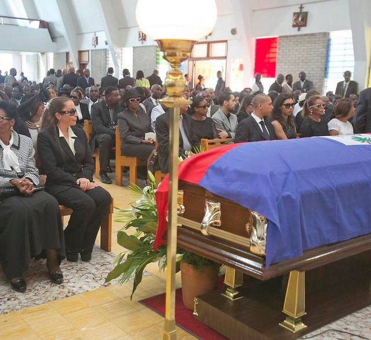 "Longtime Duvalier companion Véronique Roy (in sunglasses at left) and ex-wife Michèle Bennett (at far right in white framed glasses) attend the funeral of the former Haitian dictator Jean-Claude ""Baby Doc"" Duvalier at the Chapelle Saint Louis de Gonzague in Port au Prince, Haiti on Saturday, Oct. 11, 2014.   http://www.miamiherald.com/news/nation-world/world/americas/haiti/article2683615.html"