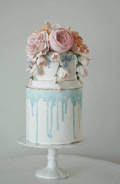 Featured Cake: The Cocoa Cakery; Unique blue melted detail wedding cake.
