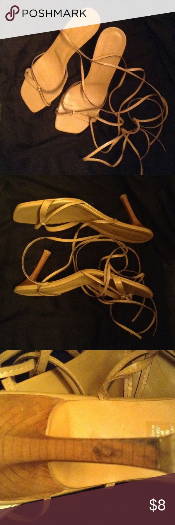 Open toe strap up heels Good condition black mark on one of the heels as shown in picture. Shoes wrap around your ankle making an attractive look. Heel is 3 1/2 inches. Bruno Valenti Shoes Heels