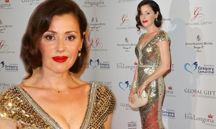 5/13/14.   Singer Tina Arena shimmers at Paris gala in gold and silver gown by Australian designer Johanna Johnson