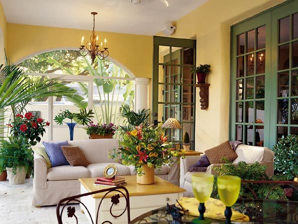 I have lots of large plants in my sunroom and have problems arranging furniture around the plants... need inspiration