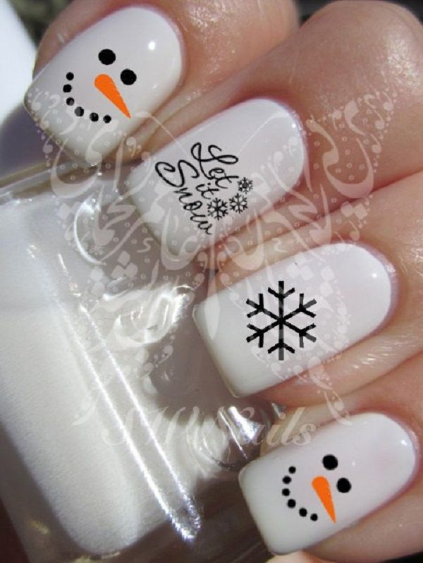 Snowman inspired nail art. White is the key polish in this design along with black for the details and orange for the nose. A very simple and pretty nail art design.