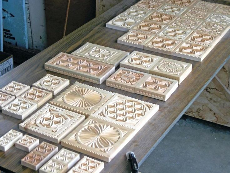 Freshly carved wooden plaques, serving platters, trivets, and coasters - with traditional motifs popular in the Pokuttya and Hutsul regions of Carpathian Western Ukraine (Made and carved by Dave Melnychuk)