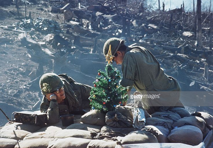 Picture taken 25 December of soldiers taking rest close to a small Xmas tree, on their position at the Hill 875 near Dakto, few days after the North Vietnamese Army made a massive assault.