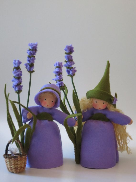 Lavender Flower Child Waldorf Inspired by KatjasFlowerfairys... The little Girl is made of 100 % wool-felt, fairy tale-wool and tricot material. The doll is approx. 13,5 centimeters high The filling is sheep wool