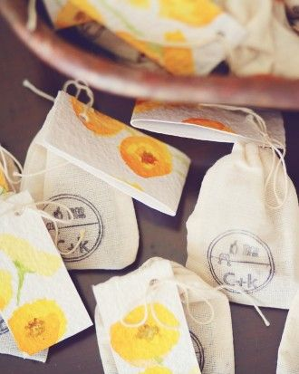Small muslin bags stamped with the couple's logo and wedding date were filled with poppy seeds.  Maybe do Kenyan coffee?