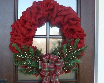 This beautiful red burlap wreath has the perfect mix of traditional and warm, country Christmas feel to it! It is decorated with greenery, pine cones, cream and light gold berries, and a lovely handmade Christmas bow! All of my wreaths are handcrafted, and this wreath measures approximately 24-25 side to side and 5-6 deep. If you need a larger size, please send me a convo message and we can create exactly what you need! Thank you for looking in my shop and have a blessed day