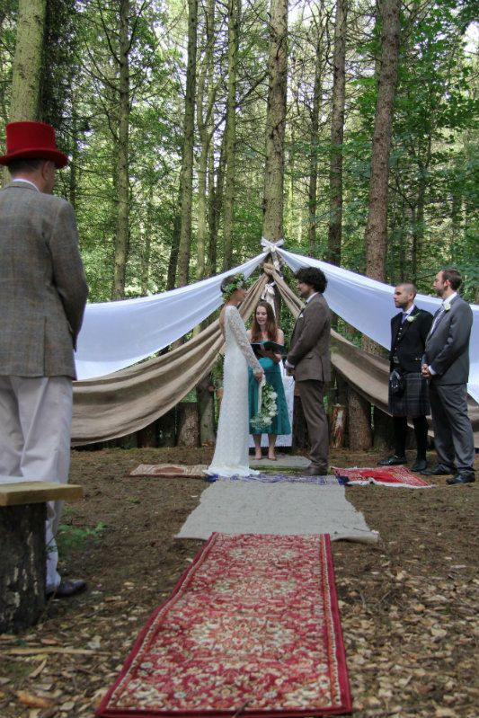 Emily and Sean's Laid Back Boho Woodland Festival Wedding…. rugs / carpet offcuts are a great shoe saving idea!