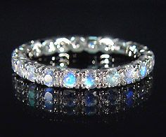 Moonstone eternity ring.. I love love LOVE this!! This would be beautiful layered