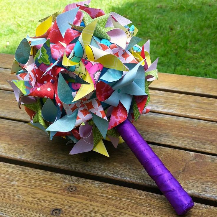 Bright and colourful carnival inspired alternative bouquet. Paper pinwheel bouquet in bright colours with buttons. Bouquet from Bouquets and Beyond