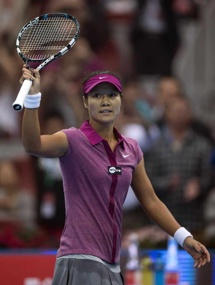 Na Li acknowledges the spectators after she defeated Daniela Hantuchova in their opening round of the China Open tennis tournament at the National Tennis Stadium in Beijing, China Sunday, Sept. 29, 2013.