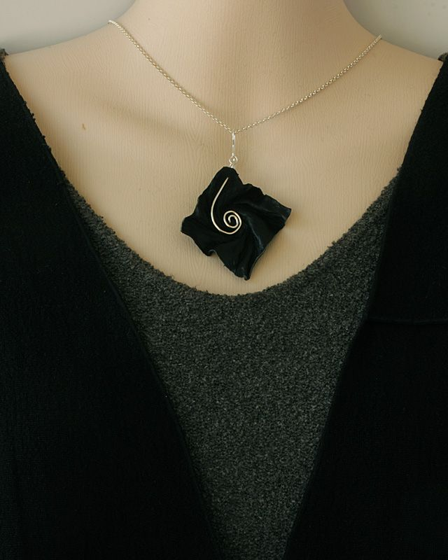 Necklaces - Pendants / Design Airi Hietala Light and delicate, but lasting jewellery made of ecological material, parchment.