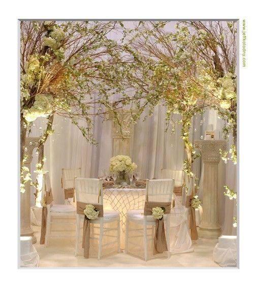 Like the lighted table with cream pintuck. Glows in a room.