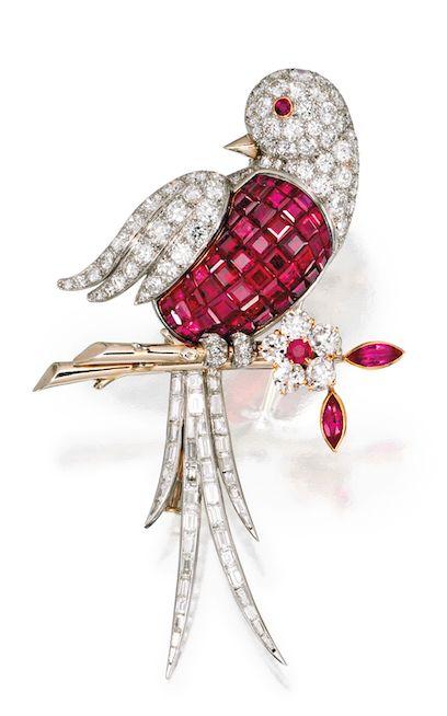 A PLATINUM, 18 KARAT GOLD, DIAMOND AND MYSTERY-SET RUBY BIRD BROOCH, VAN CLEEF &...