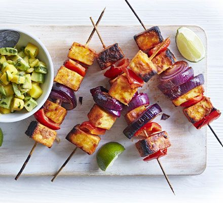 This quick vegetarian main is perfect for weeknights - grill skewers of paneer cheese and veg, then serve with a fruity avocado salsa