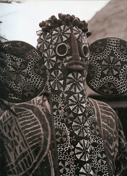 Africa | Masquerader wearing a traditional beaded Elephant mask, that is 'used' by the Bamileke people of Cameroon