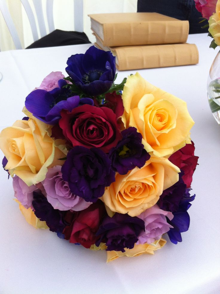 Contrasting colour bouquet with purple anenomes, memory lane, peach avalanche, and blueberry roses, and lilac lisianthus