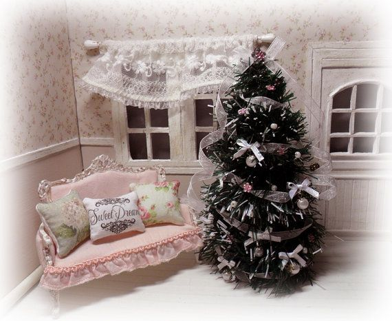 Beautiful Christmas tree shabby chic style. Decorated with beads, ribbons, organza and beads, all in shades of pink and white which gives the
